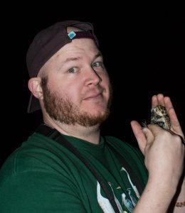 John Muller holds a Chestnut-collared Longspur